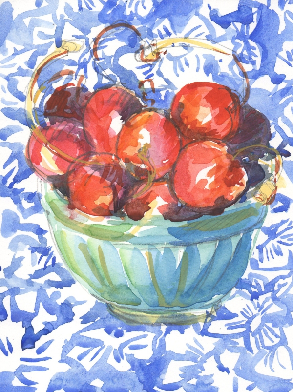 cherries in tuquoise bowl on blue patterned cloth