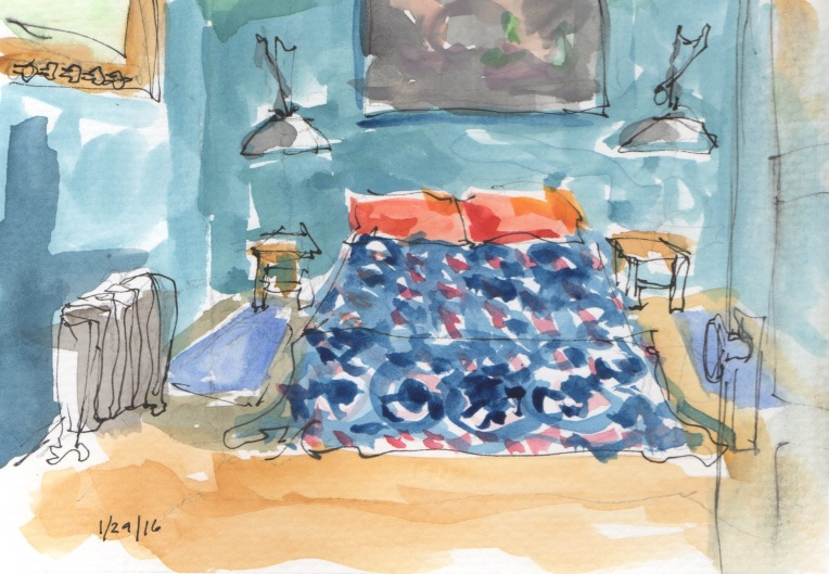 room with blue bed spread